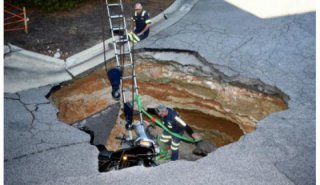 A man as well as his motorcycle, fell in a sinkhole.